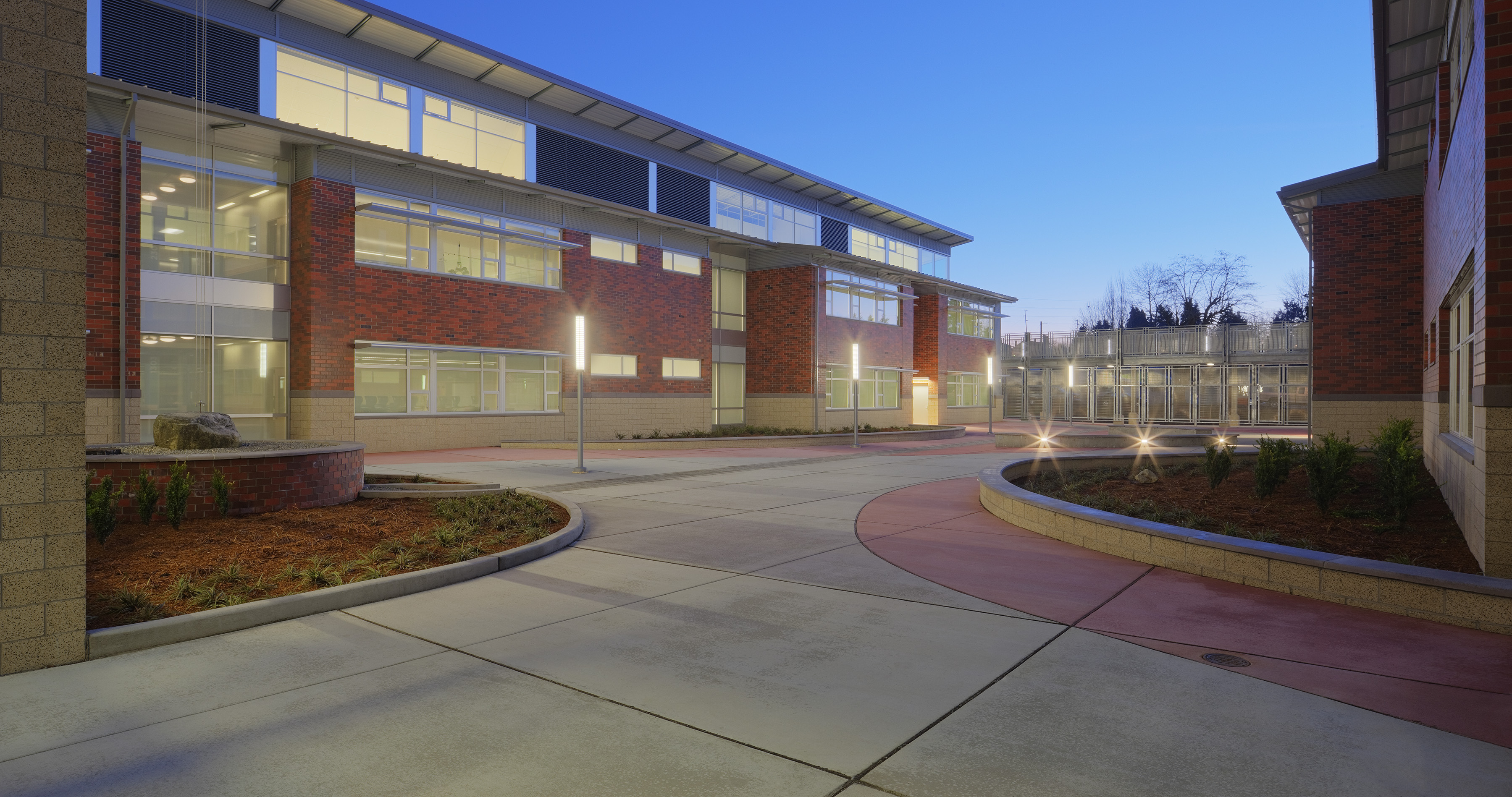 Fig. i-11 (above) Baker Middle School (opened in 2012) showcases roof overhangs that assist in deflecting rainwater away from the building enclosure below. Sun shades over windows also assist with controlling solar loads and reducing rain exposure.