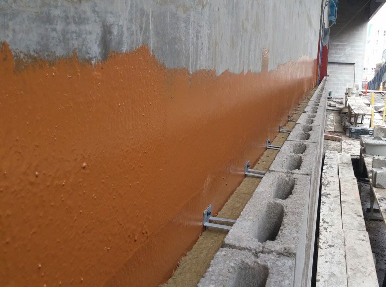 Fig. 1-5 Fluid-applied AB/WRB membrane over concrete backup wall alternate. Double eye and pintle masonry veneer ties penetrate through the exterior semi-rigid mineral fiber insulation.