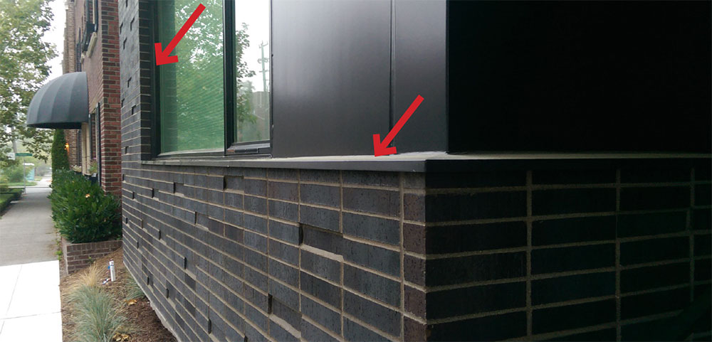 Fig. 2-16 A sheet-metal flashing conceals the top of the rainscreen cavity and masonry at this windowsill area. The sheet-metal flashing extends beyond the masonry veneer face to deflect water away from the veneer. Sheet-metal trim is also used at the window jamb condition beyond to close off the rainscreen cavity.