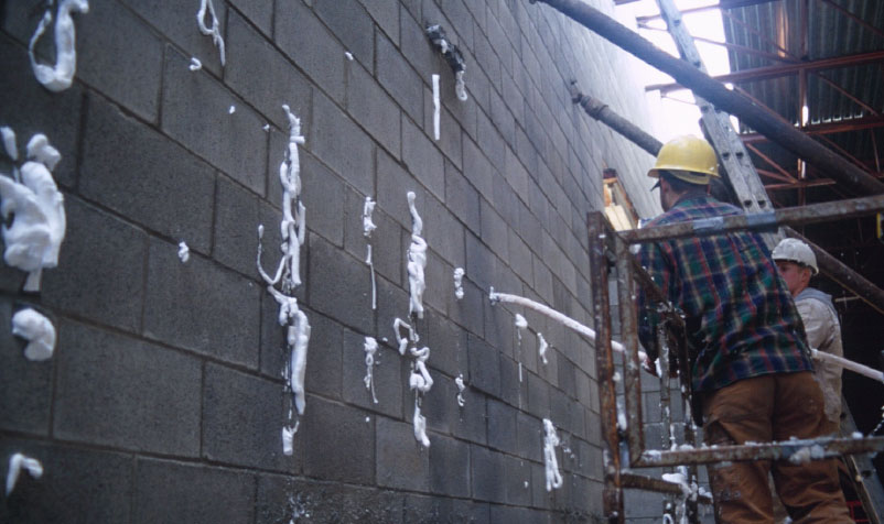 Fig. 4-4 Installation of self-expanding foam-in-place CMU core insulation.
