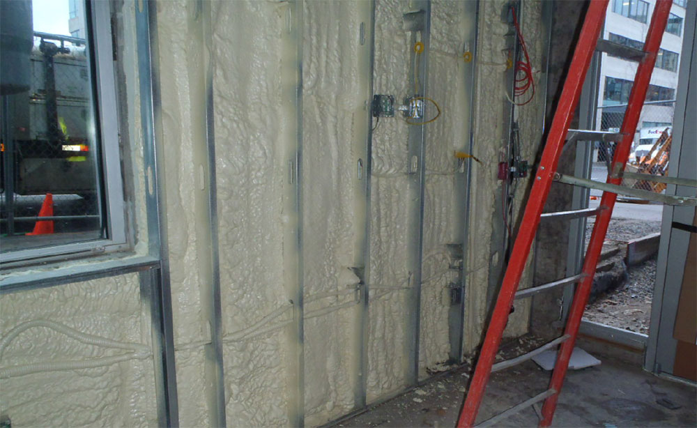 Fig. 5-4 Closed-cell spray foam insulation installed between steel studs.