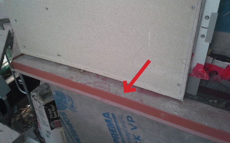 Fig. 6-10 Cross-cavity sheet-metal flashing shown below cement backer board