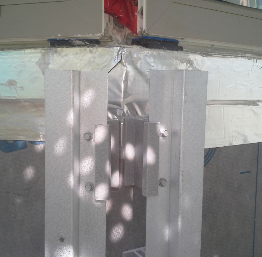 Fig. 6-11 Hot-dipped galvanized steel Z-girts attached to fiberglass cladding support clips.