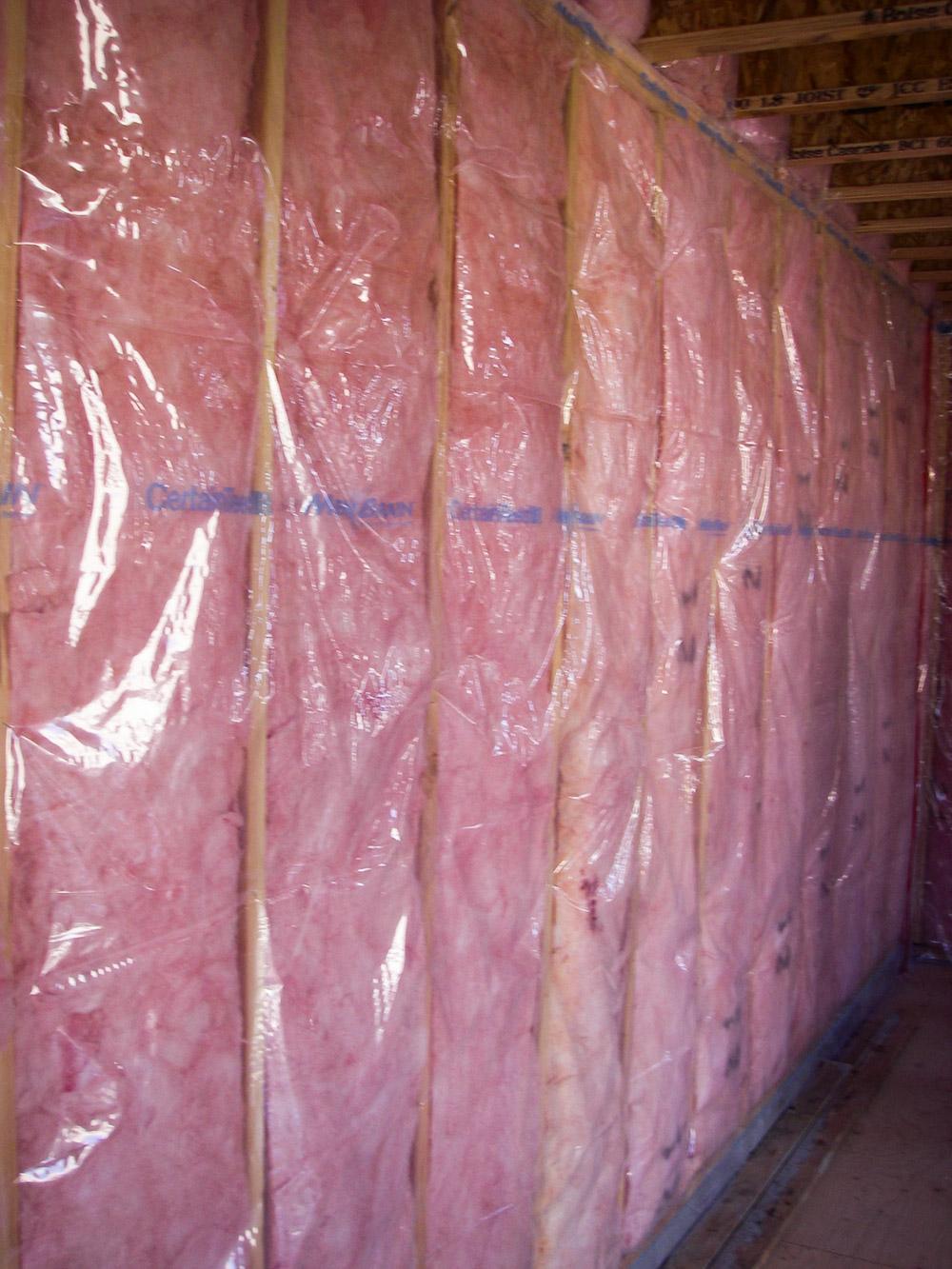 Fig. i-19 Polyamide film vapor retarder installed over a wood-framed wall with cavity batt insulation