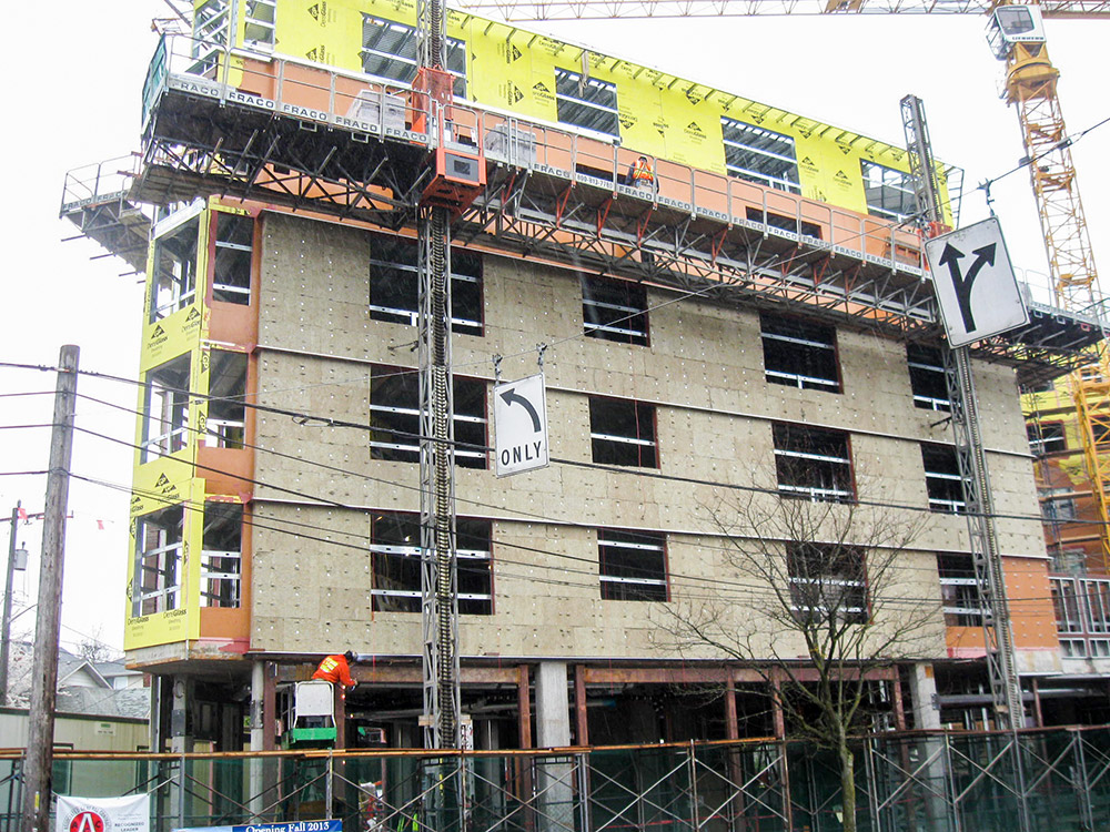 Fig. i-20 Semi-rigid mineral fiber insulation prior to anchored masonry veneer installation