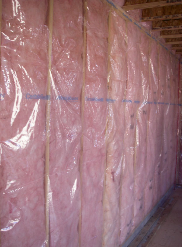 Fig. i-14 Polyamide film vapor retarder installed over a wood-framed wall with cavity batt insulation.