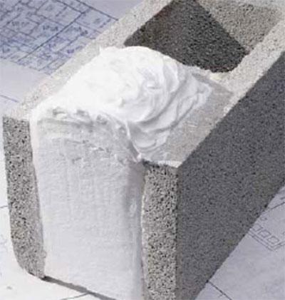Fig. i-20 Foam-in-place CMU core insulation.