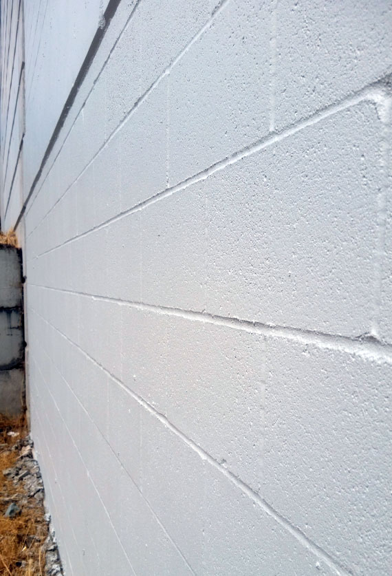 Fig. i-38 Exposed CMU wall coated with elastomeric coating.